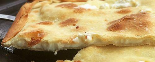 Focaccia di Recco, rustic cheese filled Italian Focaccia