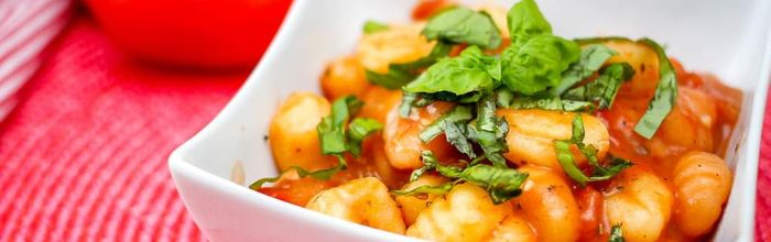 Gnocchi with tomato and pine nut sauce