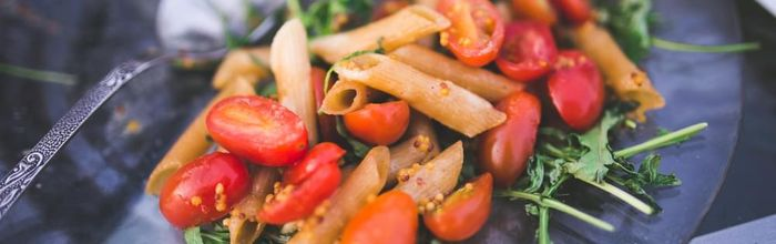 Summer pasta with rocket salad and cherry tomatoes