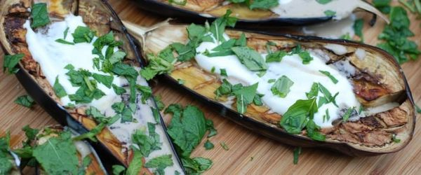 Aubergines with herbs, black rice and salad